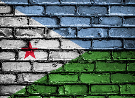 royalty free photo: National Flag of Djibouti on a Brick Wall Stock Photo