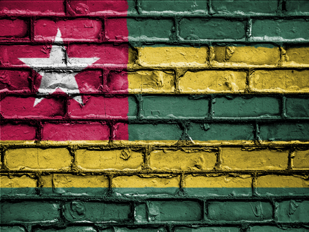 royalty free photo: National Flag of Togo on a Brick Wall