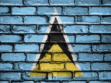 royalty free photo: National Flag of Saint Lucia on a Brick Wall