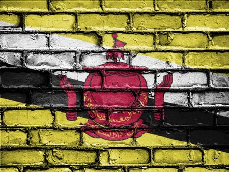 royalty free photo: National Flag of Brunei on a Brick Wall