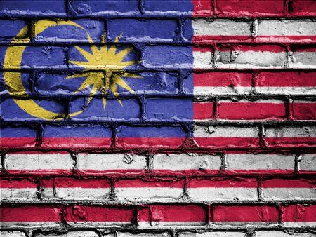 flag: National Flag of Malaysia on a Brick Wall