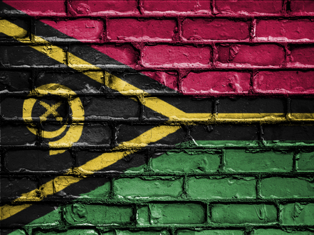 royalty free photo: National Flag of Vanuatuon on a Brick Wall Stock Photo