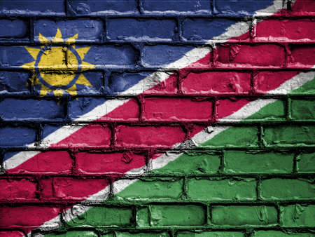 royalty free photo: National Flag of Namibia on a Brick Wall Stock Photo