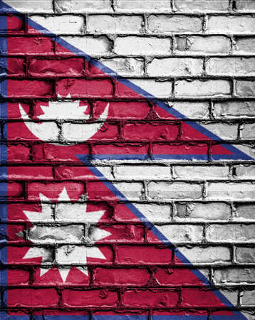 National Flag of Nepal on a Brick Wall Stock Photo