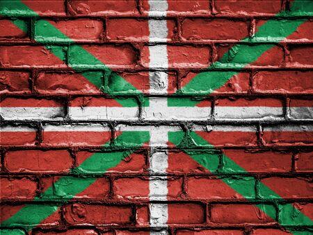 National Flag of Ikurrina on a Brick Wall Stock Photo