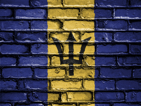 National Flag of Barbados on a Brick Wall Stock Photo