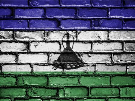royalty free photo: National Flag of Lesotho on a Brick Wall Stock Photo