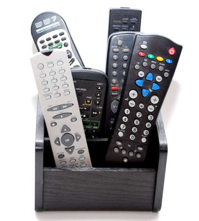 assorted tv remote control on the white background Stock Photo