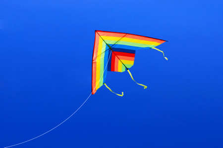 colored kite image on the blue sky background