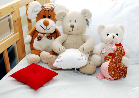 Soft toys on babys cot Stock Photo