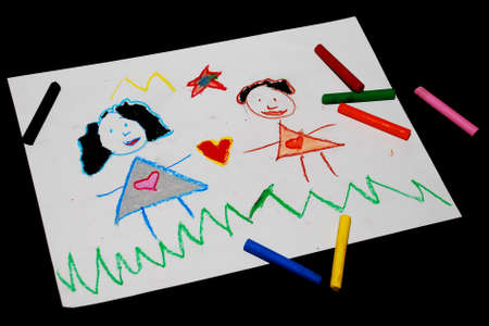 Childrens drawing and pencils on the table  Stock Photo