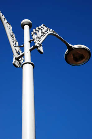 lampost: pillar lamp on the blue sky background Stock Photo