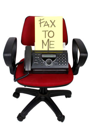 fax machine: fax machine on the red chair Stock Photo