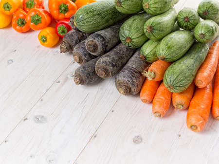 Peppers, carrots and courgettes with white space Archivio Fotografico