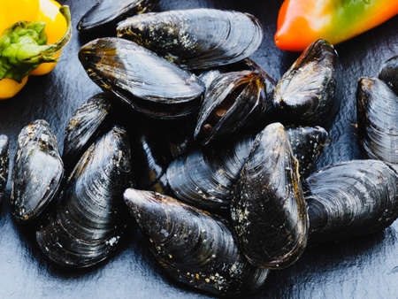 Fresh mussels fished with peppers Archivio Fotografico