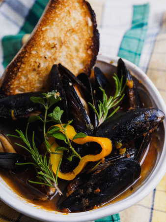 Mussels and peppers soup with bread Archivio Fotografico