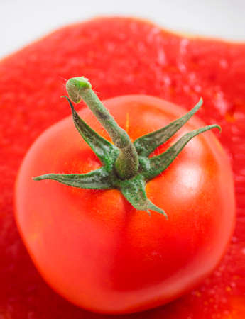 Juicy red tomato isolated