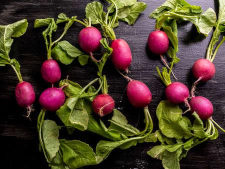 Fresh radishes on a black background