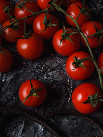 A Still life on black background of little tomatoes - Sicily - Pachino Archivio Fotografico - 131710077