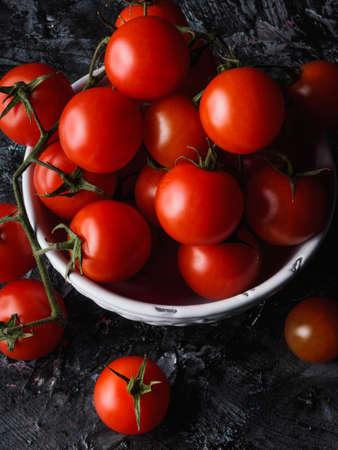 A Still life on black background of little tomatoes - Sicily - Pachino Archivio Fotografico - 131709606
