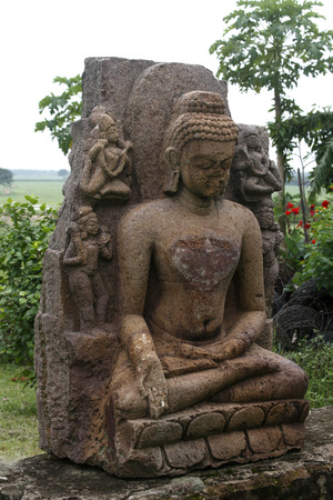 Ruined statue of Buddha in heritage Buddha excavated site,Ratnagiri,Orissa,India Stock Photo
