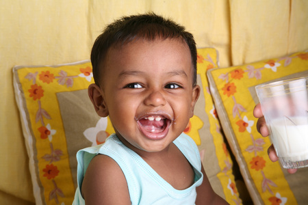 South Asian Indian small boy of 1 year laughing