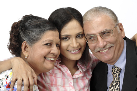 old couple and young girl standing close to each other Stock Photo