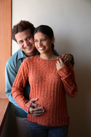 South Asian Indian pregnant woman with her husband enjoying lovely moment Stock fotó