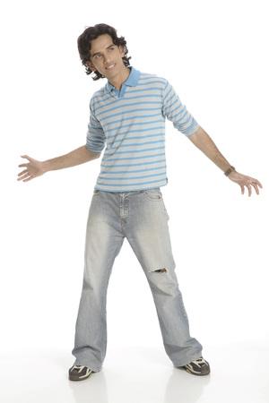 Teenage boy posing as dancing