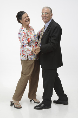 Old couple,old man and woman dancing waltz and smiling