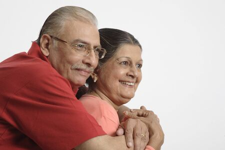 Old couple,old man holding old woman close to him and smiling