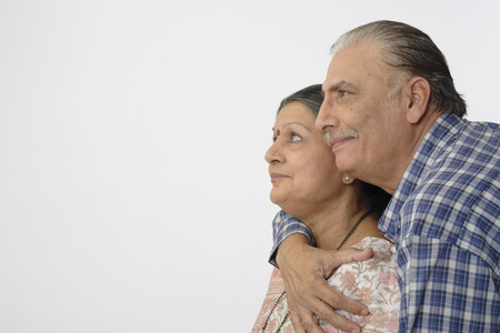 Old happy couple very close to each other and smiling Stock Photo