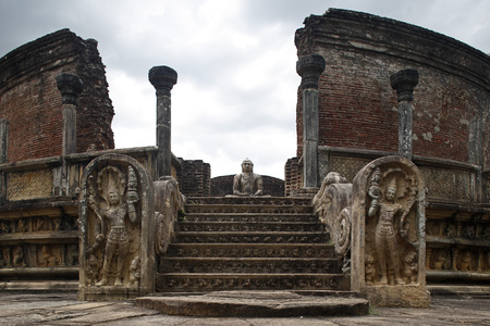 Buddha statue with ruined structure,World Heritage site,ancient city of Polonnaruwa,Sri Lanka