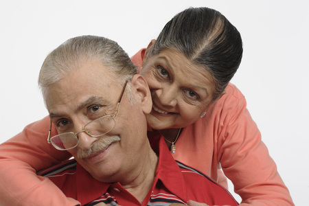 Old couple,old lady holding man from behind