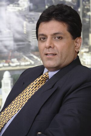 Close up face of executive looking happy in office at top floors of skyscraper in modern city