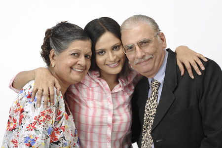 Old couple and young girl standing close to each Stock Photo