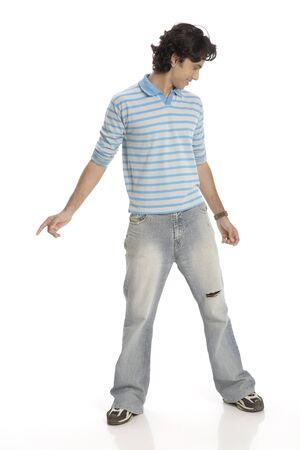 Teenage boy posing as dancing wearing t-shirt and jeans