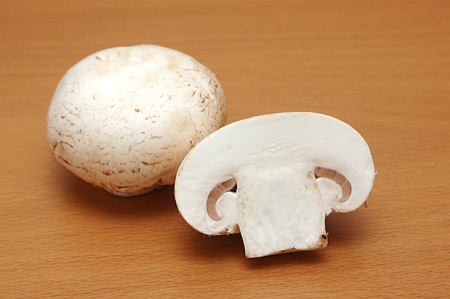 Vegetable,white button mushroom cut and chopped shape one full and half Stock Photo
