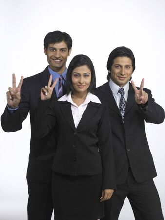 South Asian Indian executive men and woman showing victory sign Reklamní fotografie