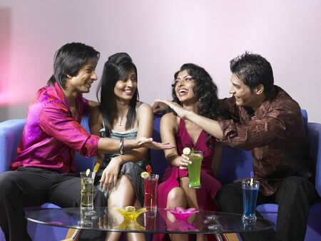 nightspot: South Asian Indian men and women celebrating party