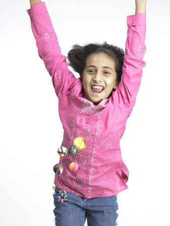South Asian Indian girl jumping with joy in nursery school