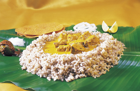 konkan: Non vegetarian meal,Konkan Cuisine,boiled rice and fish curry served on banana leaf