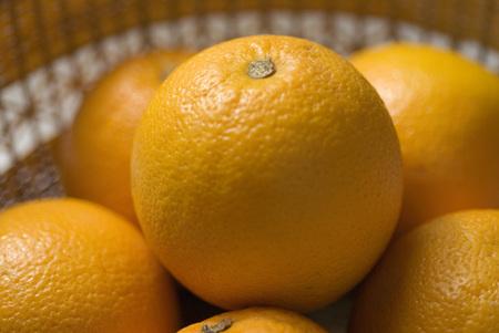 perishable: Orange fruit round citrus few in basket