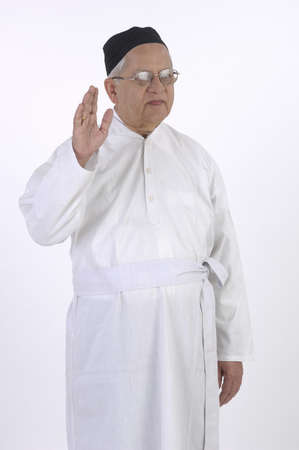 Jew priest dressed in white robe blessing posture