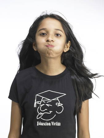 South Asian Indian young girl puffing out cheek