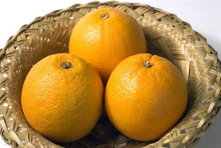 Orange fruit round citrus three in basket Stock Photo