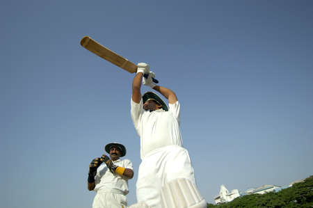 right handed: Indian right handed batsman in action playing lofted shot in cricket match