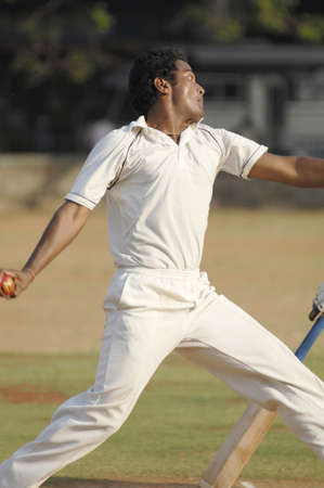 Cricket,fast bowler in bowling action