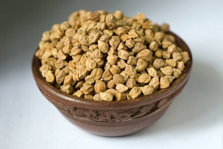 perishable: Chana brown gram seeds in round wooden bowl vegetable