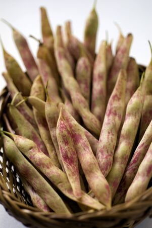 rajma: Rajma beans in round wooden bowl pods cream and dark pink legume vegetable fresh LANG_EVOIMAGES